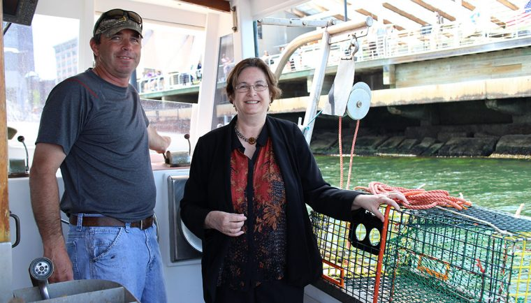 Aquarium president with lobsterman on boat