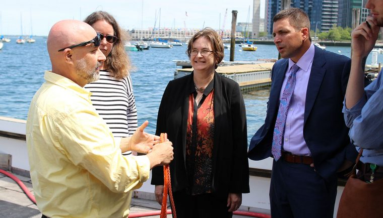 scientists and mass. secretary on boat