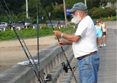 fisherman on a pier tying hook