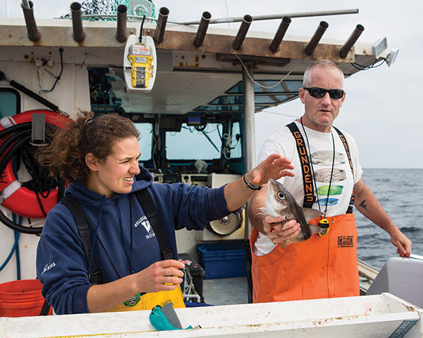 [IMG] Anderson Cabot Center scientists fish for Haddock on a boat during a research trip.