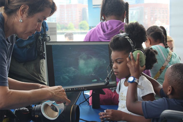[IMG] Children at 2018 World Oceans Day try on aerial survey equipment.
