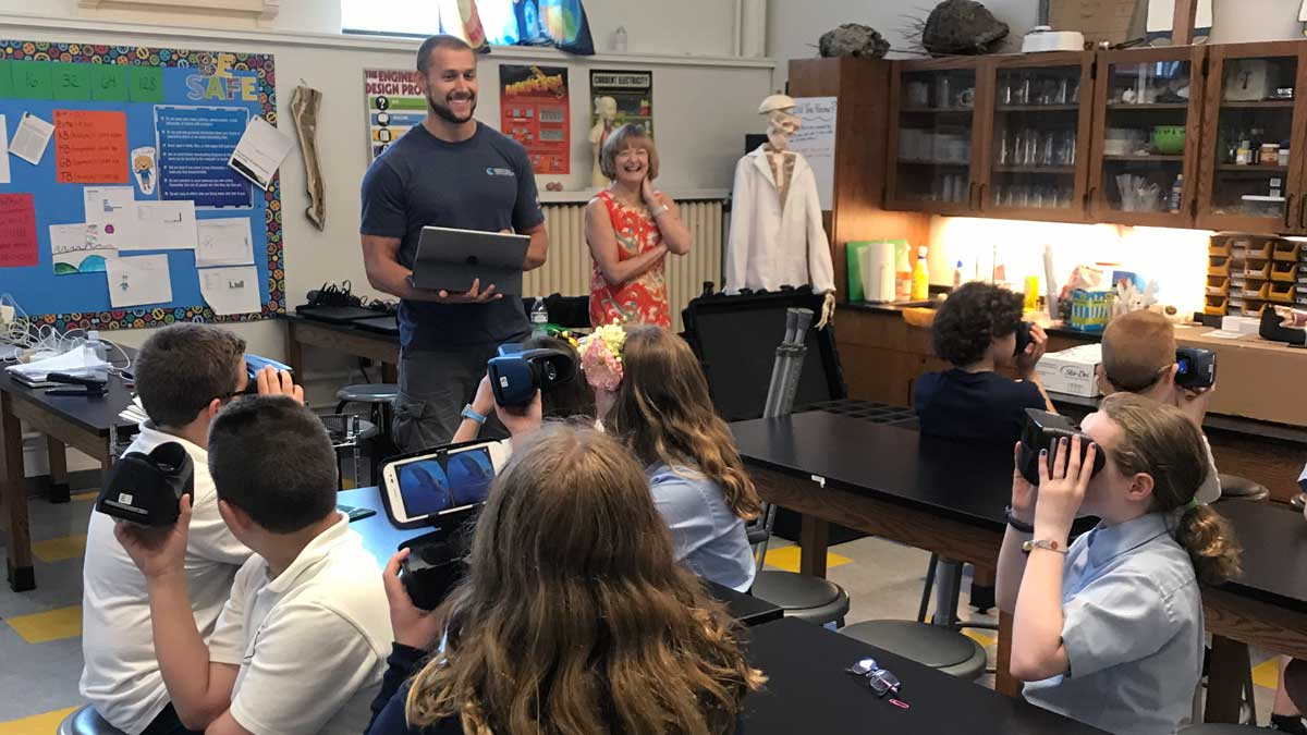 Ryan Knotek (University of Massachusetts Boston Ph.D. candidate) leading students from St. Clements Elementary School (Saratoga Springs, NY) through the Google Expedition for the first time.