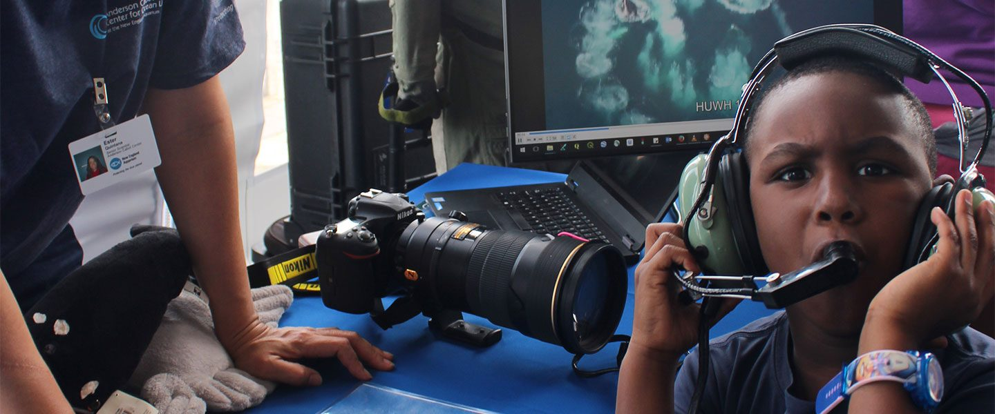 [IMG] Kid at World Oceans Day learns what it's like to be on an aerial survey.