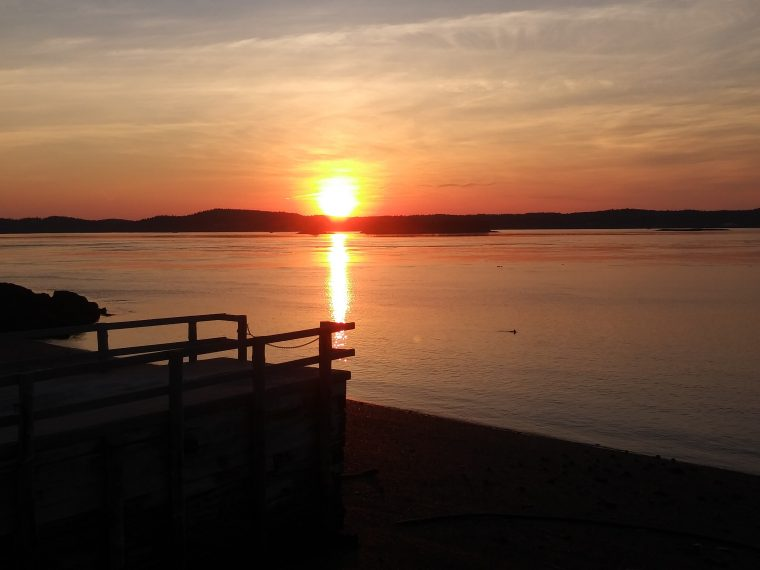 Sunset off the dock in Lubec, Maine.