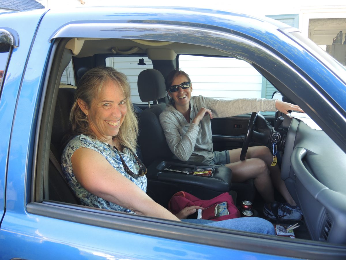 ACCOL team members in a car.