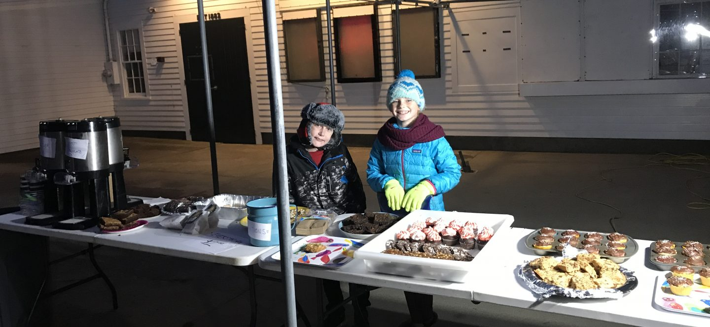 two girls at bake sale