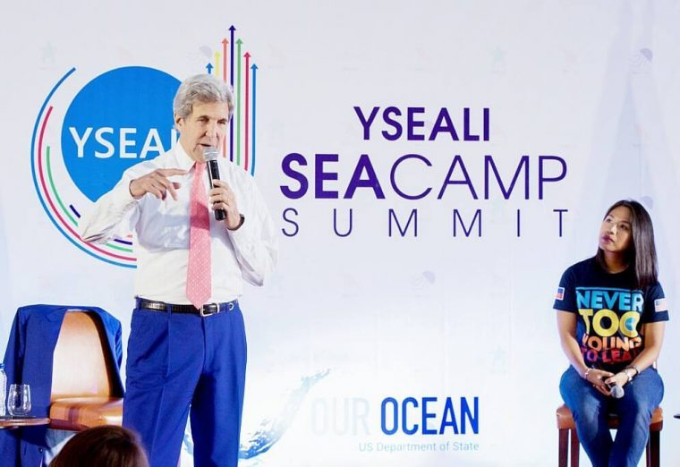 Anna on stage with John Kerry at the YSEALI Seacamp Summit
