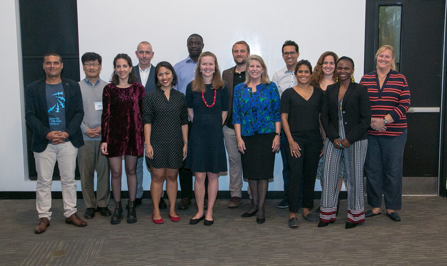 The New England Aquarium MCAF Fellows gathered in Boston for the inaugural summit this fall (from left, Andres Lopez, Florencia Vilches, John Flynn, Anna Oposa, Tomas Diagne, Shah Selbe, Daniel Fernando, Asha de Vos, Ph.D., Nelly Kadagi, Ph.D., and Lucy Keith-Diagne, Ph.D. Also shown are Mark Huang, Managing Director of SeaAhead (second from left); Elizabeth Stephenson, Program Officer and Chair of MCAF (at center), and New England Aquarium President and CEO Vikki Spruill (sixth from right). (Photo: Reba Saldanha)