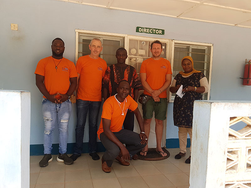 Eric Quayson, John Flynn and Neil Davis with Omar Sanyang Executive Director of Smile For Life and the Director and an assistant of the Department of Parks and Wildlife Management